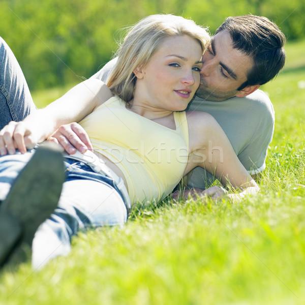 couple lying on meadow Stock photo © phbcz