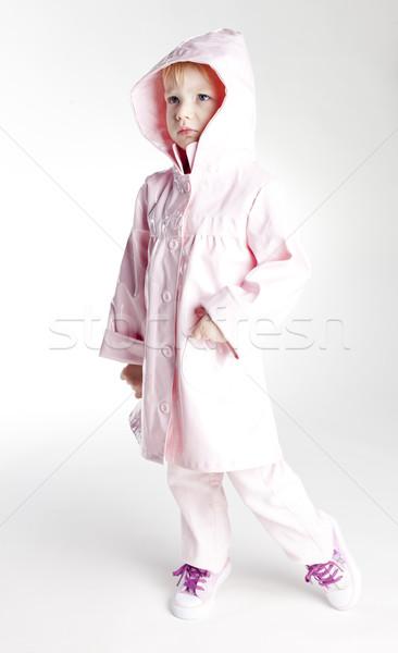 Kislány visel esőkabát gyermek rózsaszín stílus Stock fotó © phbcz
