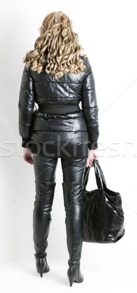 áll nő visel fekete ruházat tart Stock fotó © phbcz