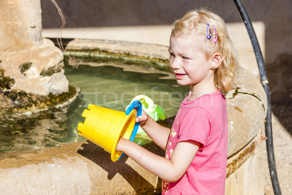 little girl playing at fountain, Ajonc, Provence, France Stock photo © phbcz