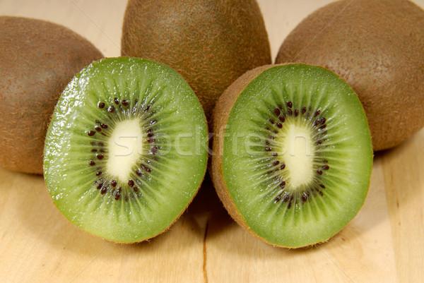 Egész kiwi gyümölcs fa asztal trópusi stúdió Stock fotó © philipimage