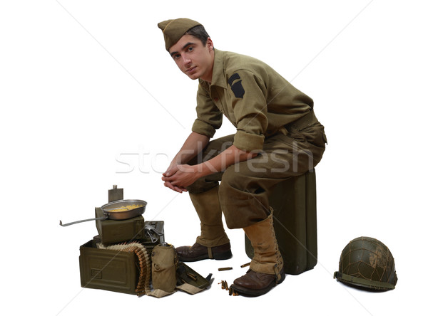 Stock photo: American soldier sitting on a jerrycan