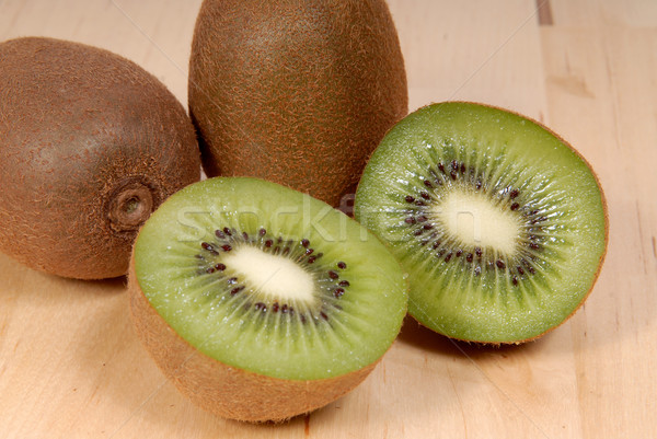 Whole kiwi fruit and his segments Stock photo © philipimage