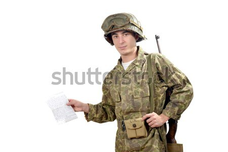 young American soldier  shows a photograph Stock photo © philipimage