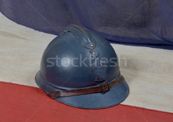 french ww 1 helmet on the antique french flag Stock photo © philipimage