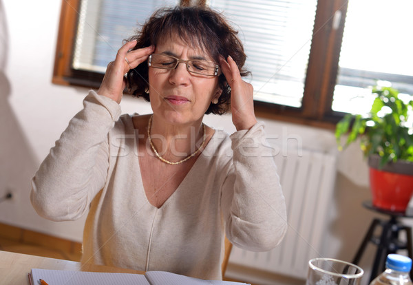 woman in the office has a headache Stock photo © philipimage