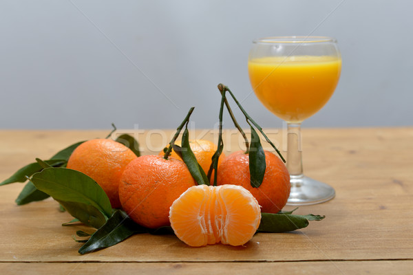 several mandarins with a glass of juice Stock photo © philipimage