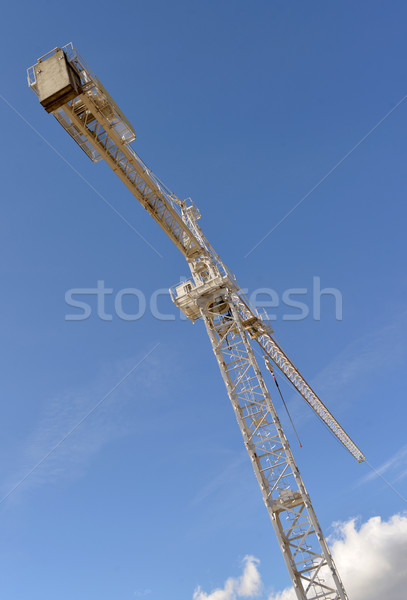 Crane against a blue sky Stock photo © philipimage