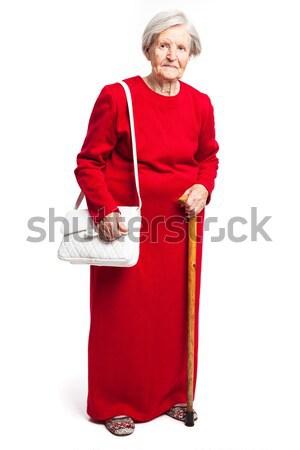 Senior woman with walking stick standing on white Stock photo © photobac