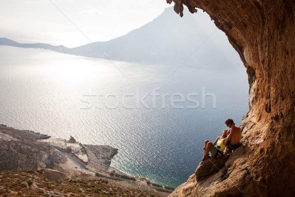 Young couple of rock climbers having a rest Stock photo © photobac