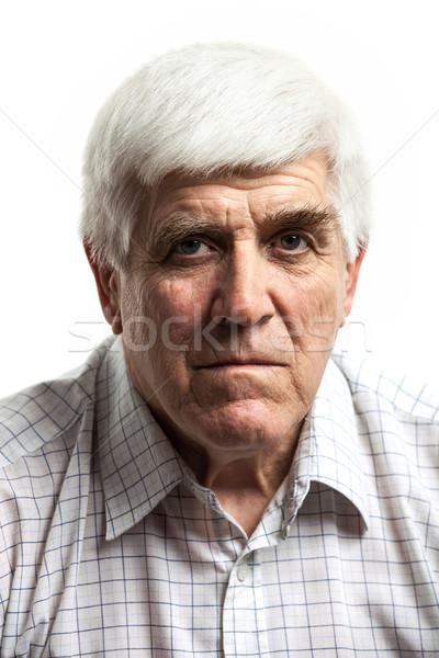 Retrato bonito homem maduro olhando câmera isolado Foto stock © photobac