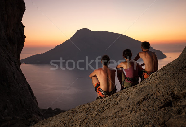 Three rock climbers having rest at sunset Stock photo © photobac