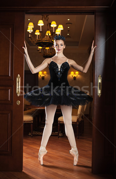 Ballerina in black tutu standing on pointes Stock photo © photobac