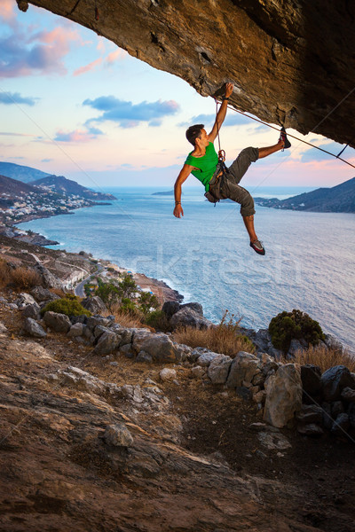 Male rock climber at sunset Stock photo © photobac