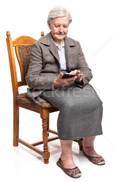 Senior vrouw mobiele telefoon vergadering stoel business Stockfoto © photobac