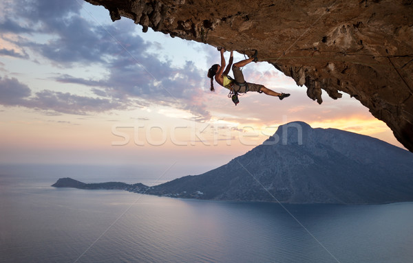 Young female rock climber at sunset Stock photo © photobac