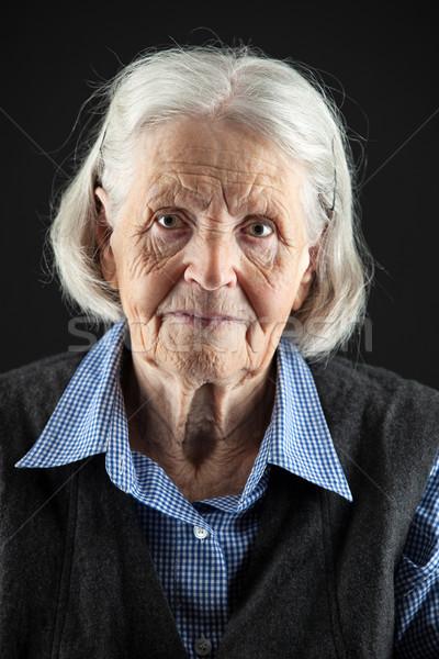 Retrato senior mulher olhando câmera Foto stock © photobac