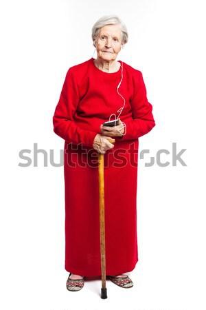ストックフォト: シニア · 女性 · 音楽を聴く · 白 · ファッション · 電話