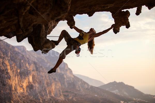 Rock coucher du soleil île Grèce ciel eau Photo stock © photobac