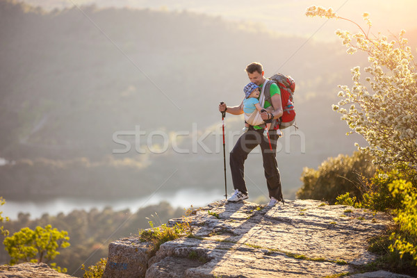 Hiker with baby relaxing on cliff Stock photo © photobac