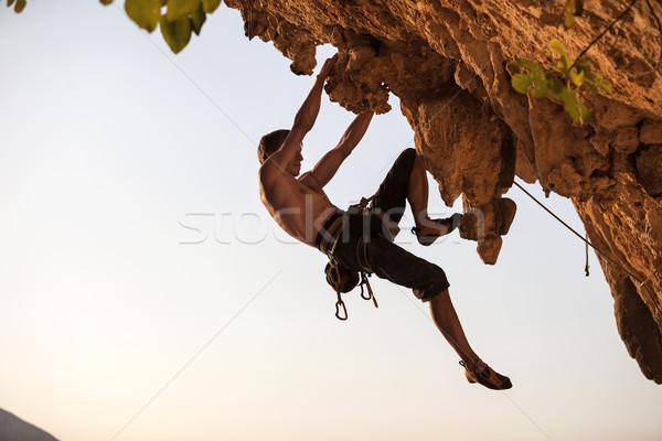 Rock climber of a cliff Stock photo © photobac