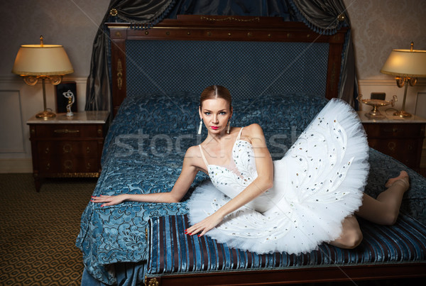 Ballerina lying down on bed in luxury interior Stock photo © photobac