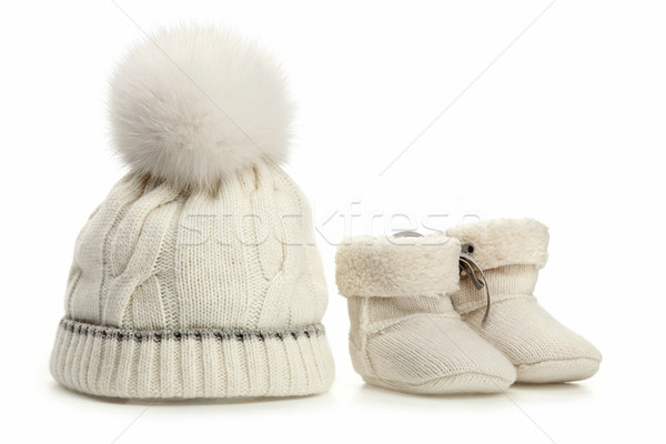 Warm woolen baby hat and booties over white Stock photo © photobac