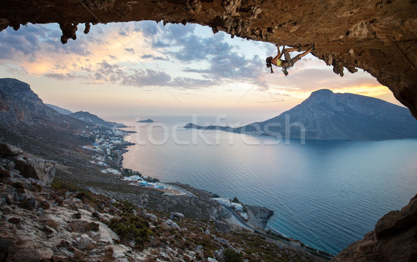 Stock photo: Female rock climber at sunset