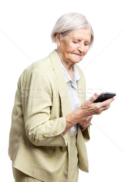 Kıdemli kadın cep telefonu beyaz iş gülümseme Stok fotoğraf © photobac
