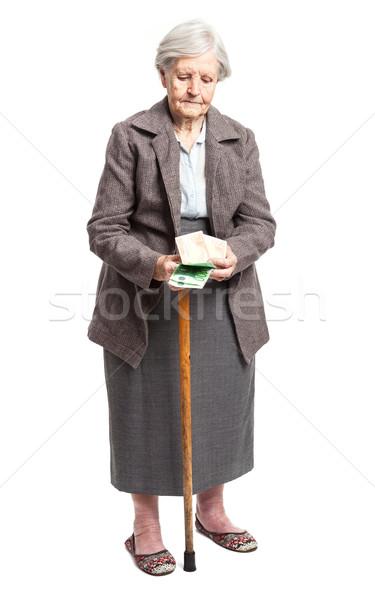 Senior vrouw geld witte permanente business Stockfoto © photobac