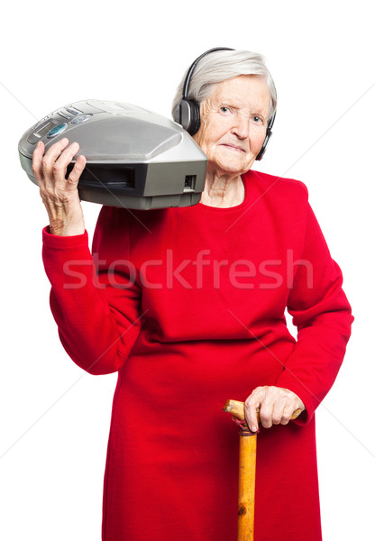 Senior woman listening to music on stereo recorder Stock photo © photobac
