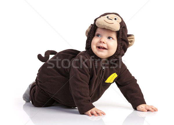 Baby boy in monkey costume looking up over white Stock photo © photobac