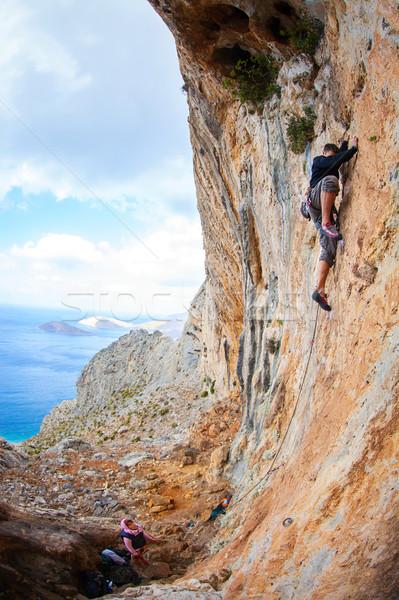 Young man lead climbing on cliff near sea Stock photo © photobac