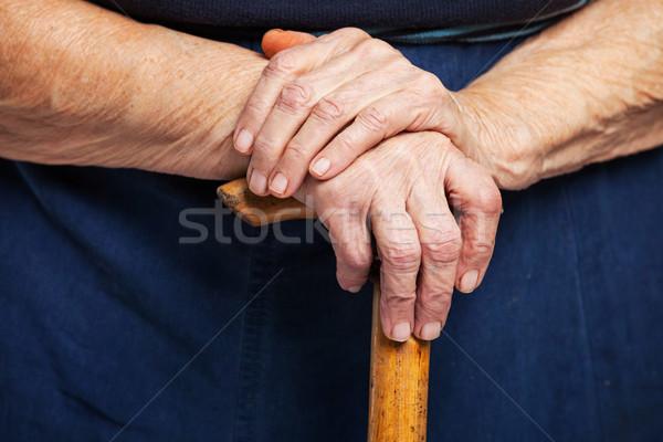Primo piano senior mani legno stick piedi Foto d'archivio © photobac