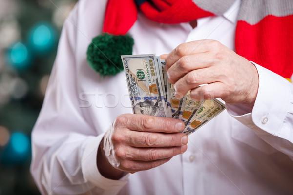 Senior homem dinheiro natal negócio árvore Foto stock © photobac