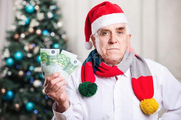 старший человека Hat деньги Рождества Сток-фото © photobac