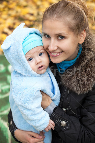 Young woman and her baby son in autumn park Stock photo © photobac