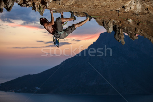 Rock climber at sunset Stock photo © photobac