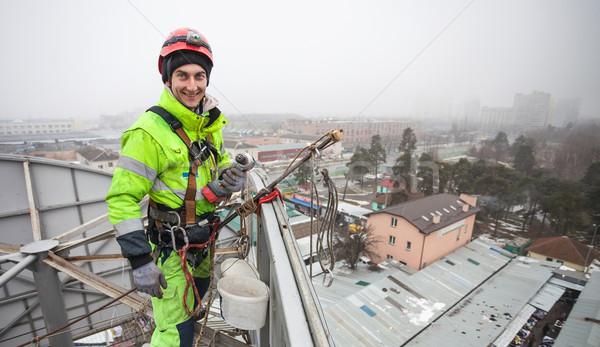 Industrial metal construção topo inverno trabalhador Foto stock © photobac