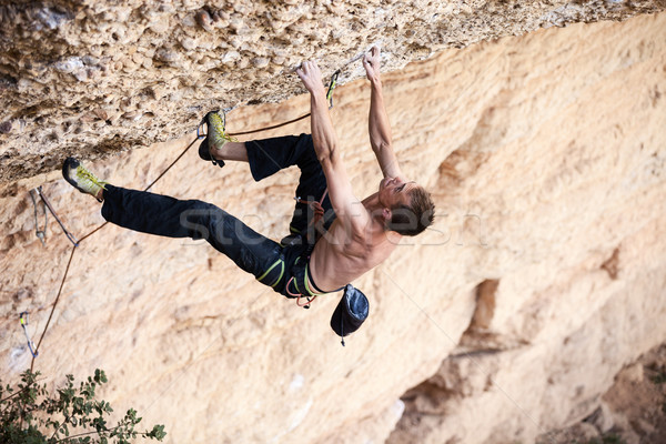 Rock climber on a face of a cliff Stock photo © photobac