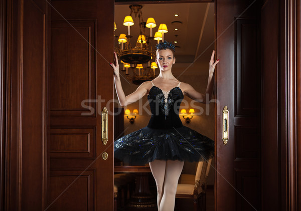 Ballerina in black tutu standing in doorway Stock photo © photobac