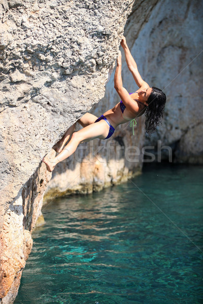 Young female rock climber on cliff Stock photo © photobac