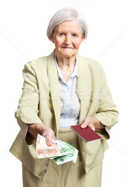 Kıdemli kadın para pasaport el Stok fotoğraf © photobac