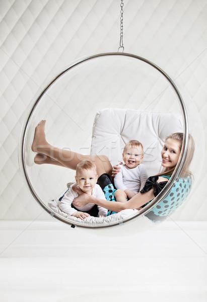 Nő kettő babák akasztás szék fiatal Stock fotó © photobac