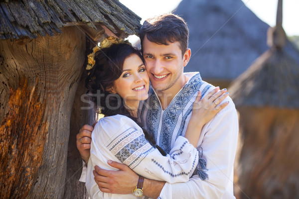Young couple in Ukrainian style clothes outdoors Stock photo © photobac