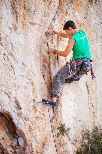 Rock climber on a cliff Stock photo © photobac