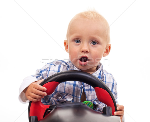 Little boy holding a toy steering wheel over white Stock photo © photobac
