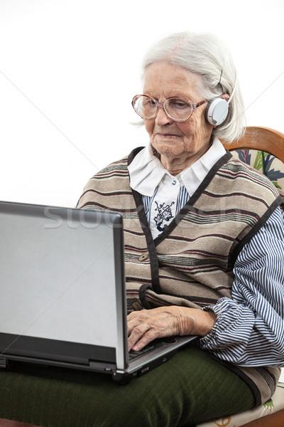 старший женщину используя ноутбук компьютер белый Сток-фото © photobac