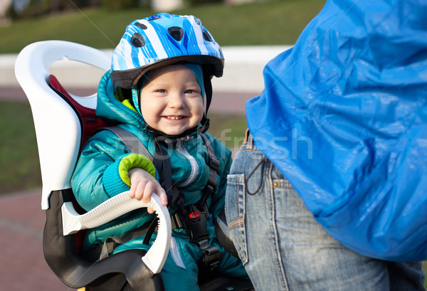 Little boy in the seat bicycle behind father Stock photo © photobac