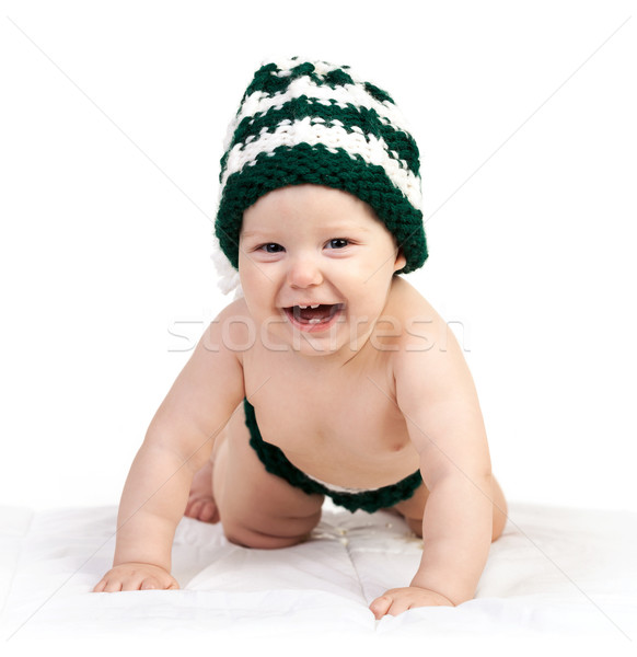 Happy baby boy in knitted hat crawling over white Stock photo © photobac